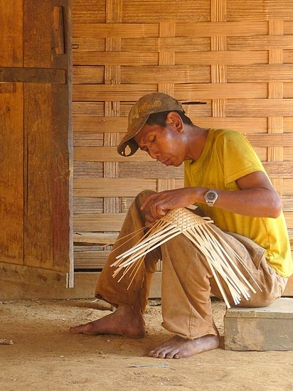 1.1289517873.a-basket-weaver-in-a-house-in-the-khmo-village